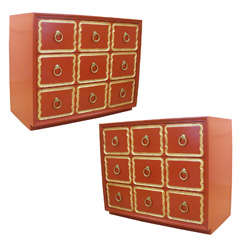 Pair of orange Dorothy Draper Espana chests of drawers.