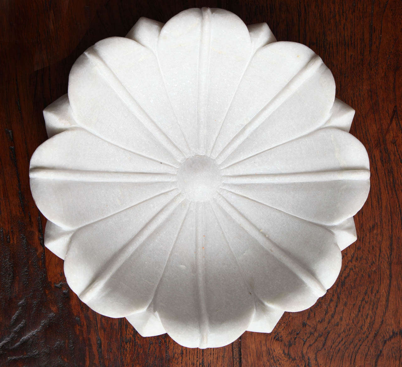 A carved white marble lotus bowl from India.