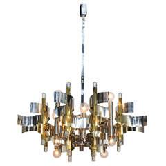 Twelve-Light Chrome, Brass and Lucite Chandelier by Gaetano Sciolari
