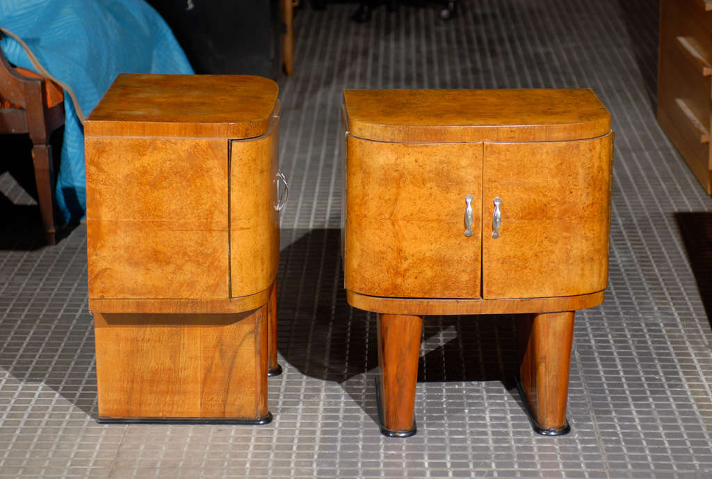 A stunning pair of French Art Deco small cabinets in book matched walnut, circa 1940.  A great size, the pair may function as end tables or night stands. Excellent Restored Condition. The pieces have been professionally cleaned and re-lacquered. The