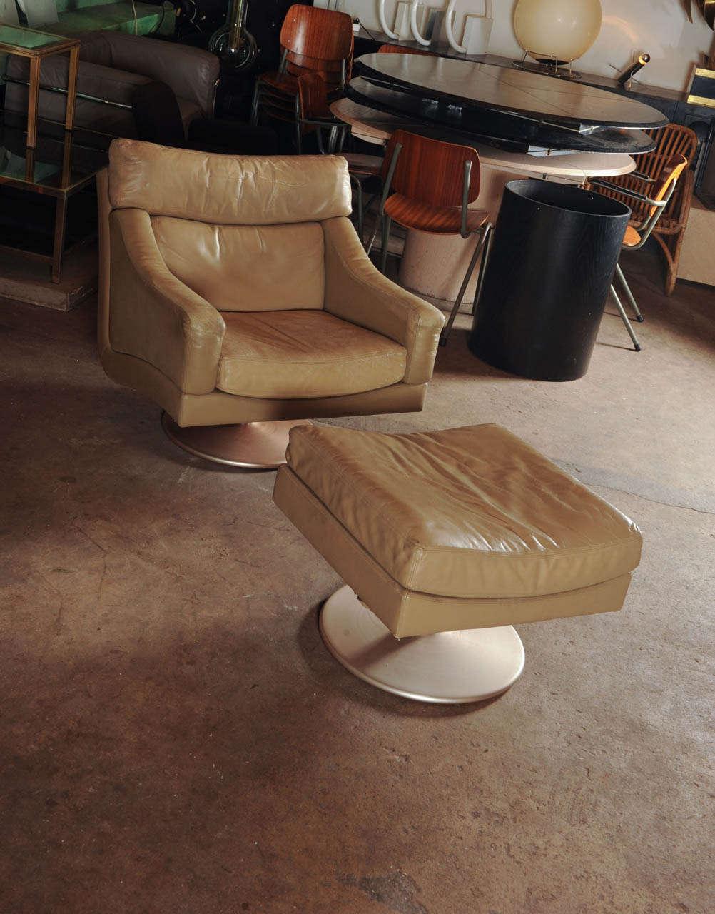 beautiful swivel club chairs | Wonderful Set Of Swiss Made Lounge Chair + Hocker at 1stdibs