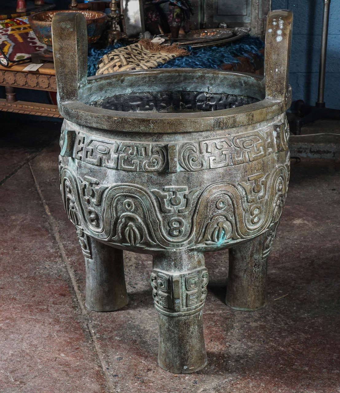 Sculptural Chinese vessel used for cooking, storage and preparation of ritual offerings to ancestors. Dating back from Xia dynasty to Zhou dynasty, they were associated with power and dominion over land.