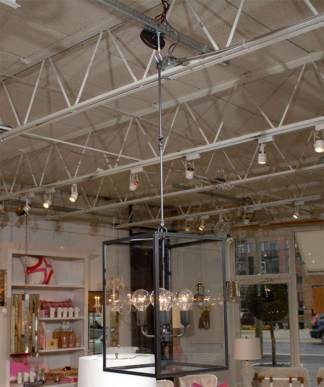 * glass pendant   * four interior lights  * holds 60 watt lights  * four glass panels   * two rod links at 14