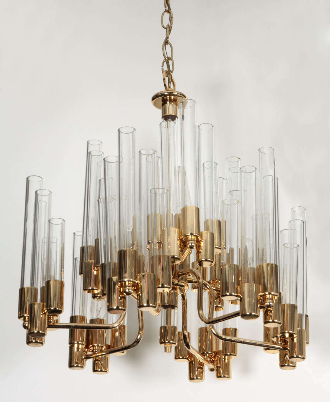 Fantastic Mid Century 2 tier brass and clear glass chandelier designed by Hans Agne Jakobsson. Bottom tier has 6 arms, top tier has 3.  Comes with 4ft of brass chain. Price reduced from 4800.