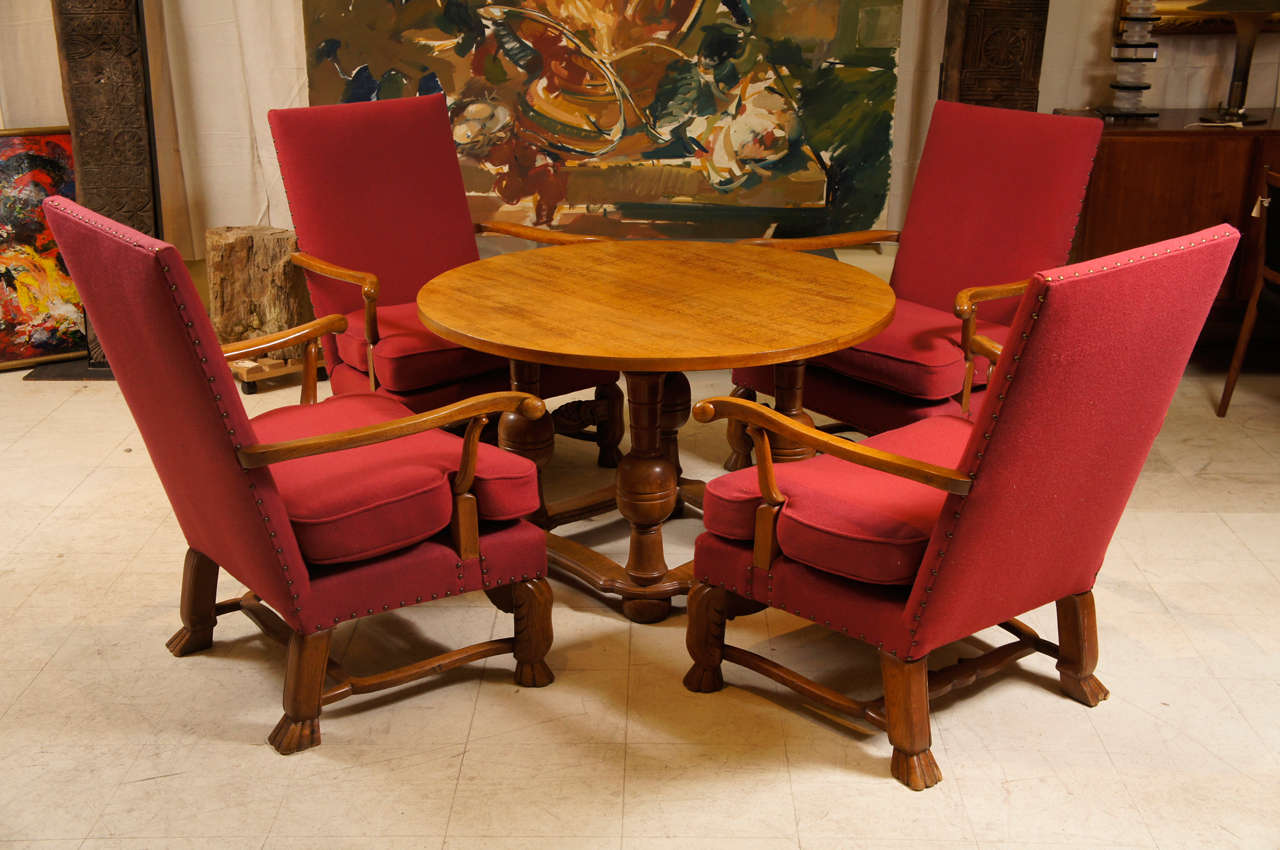 5 piece living room set, four large comfortable upholstered chairs and a round table in the baroque style.   The chairs having paw feet and the table renaissance revival turned legs.   The table measures 