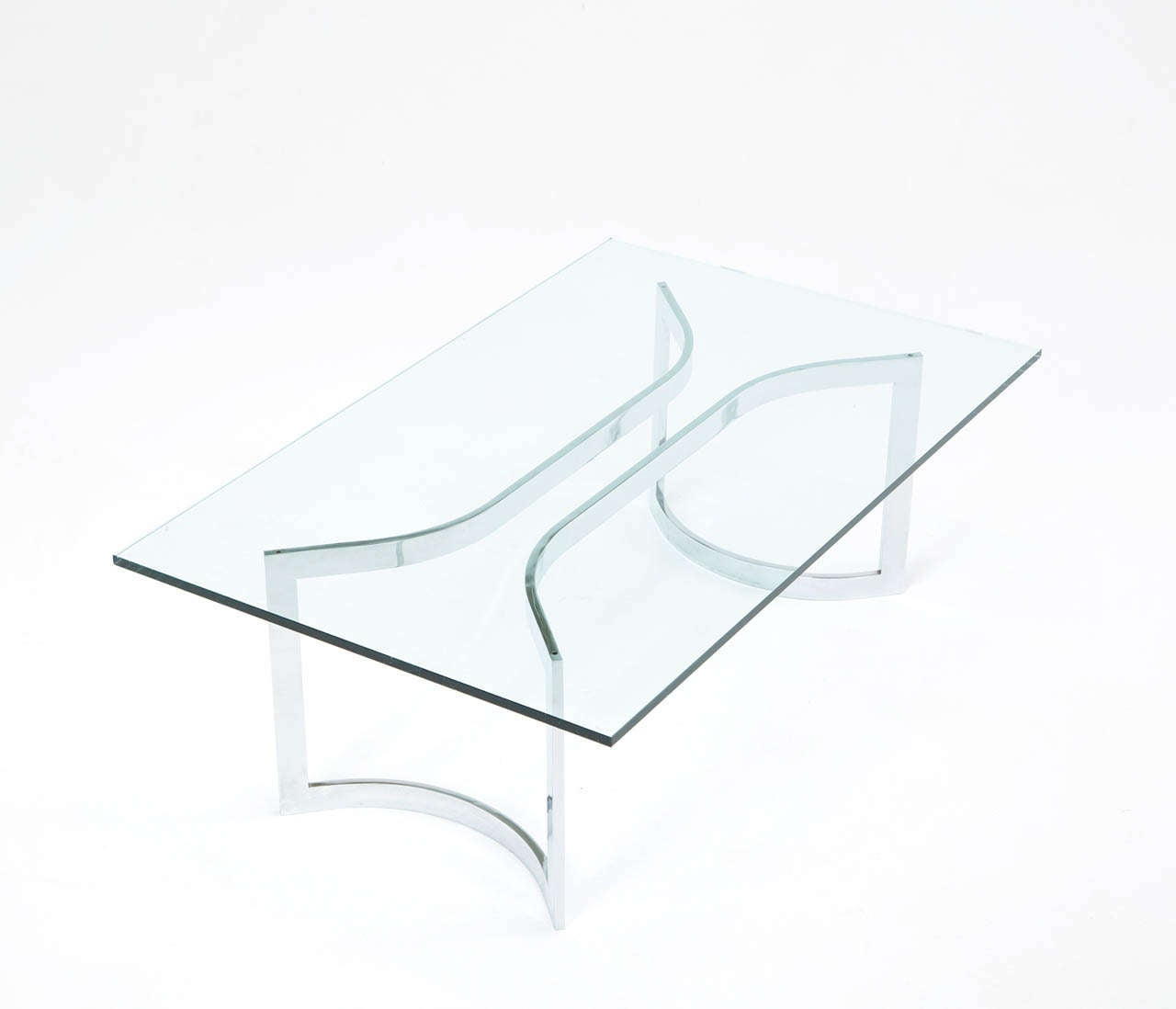 A Sculptural Mid-Century Chrome Plated Cocktail Table with rectangular glass top.   Free shipping for all European destinations and discounted shipping to all intercontinental destinations starting at $95, depending on the item of your selection.