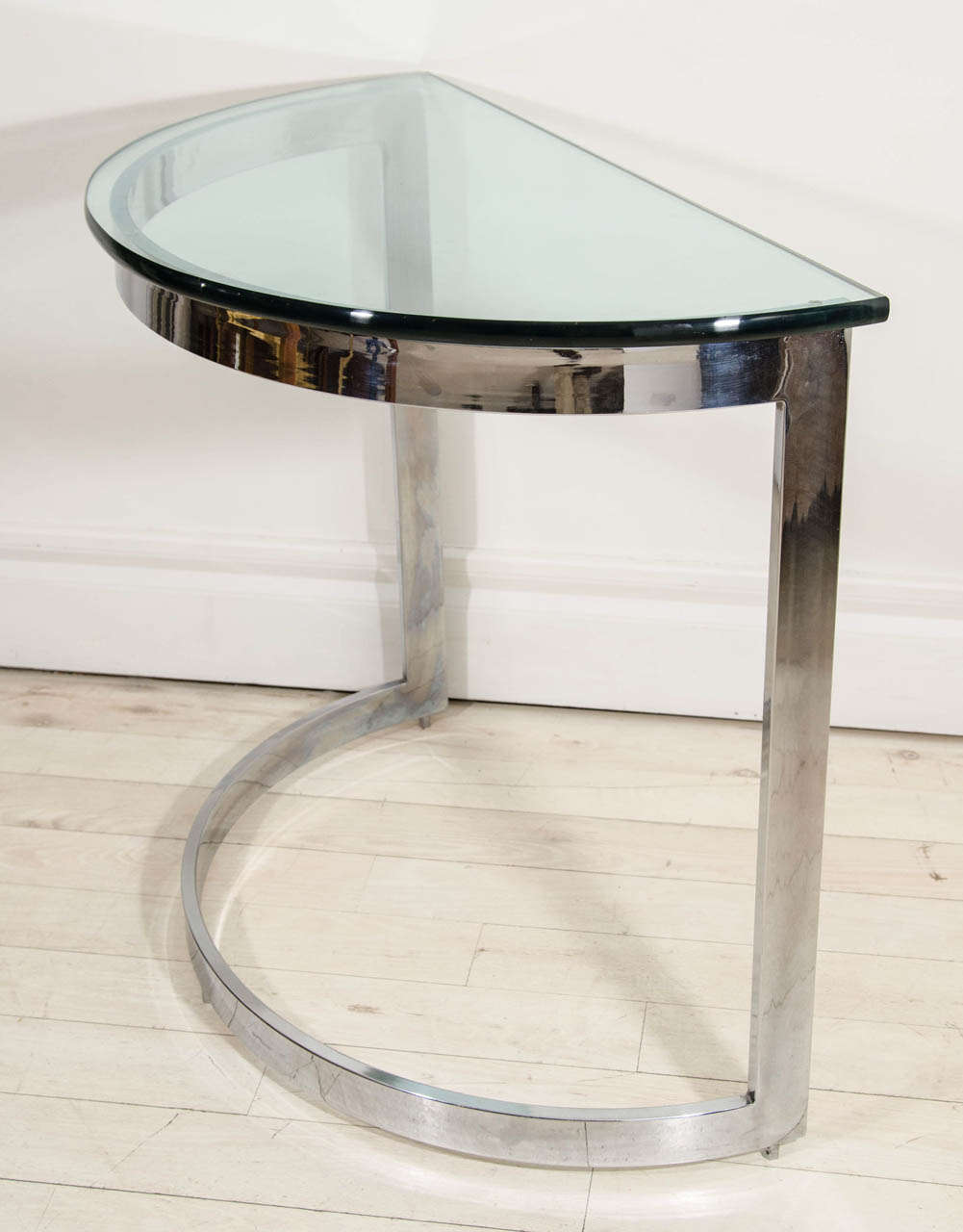 Pair Of Chrome And Glass Demilune Console Tables.