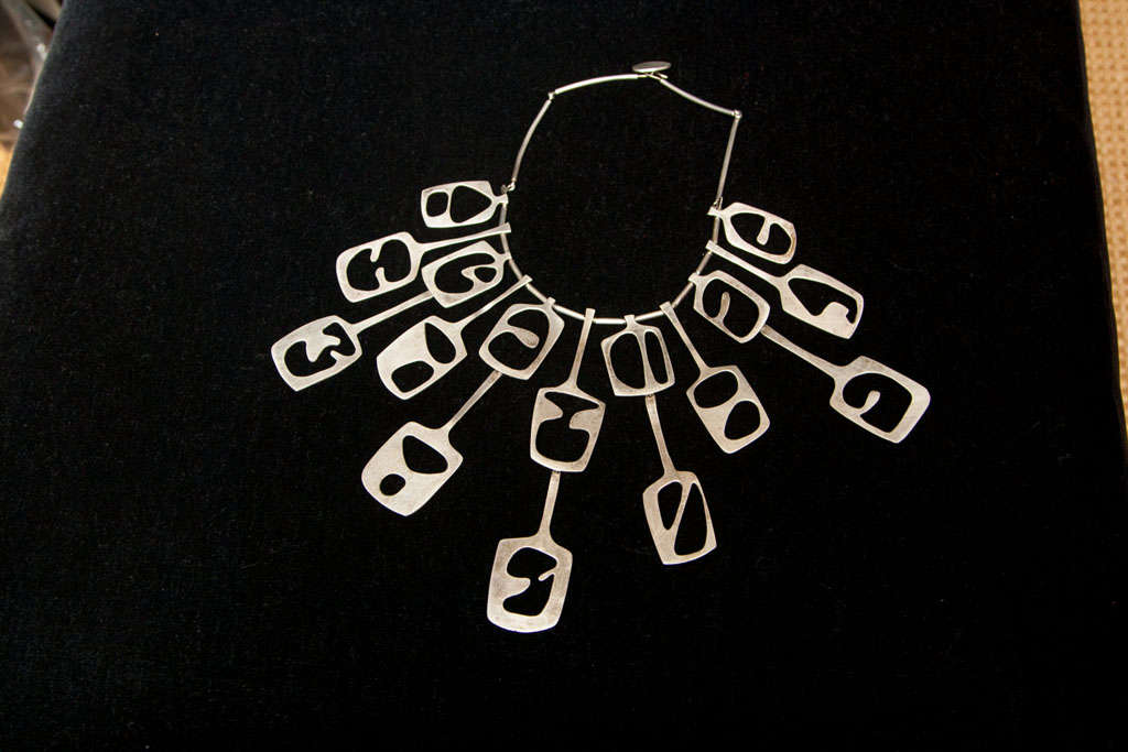 Amazing Artisan Crafted Sterling Silver Necklace.  Free Form Design Hangs in a splayed fashion on the neck and chest. Marked Sterling