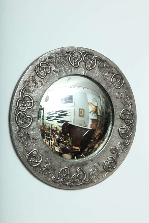 An English Arts And Crafts Hand Hammered Pewter Round