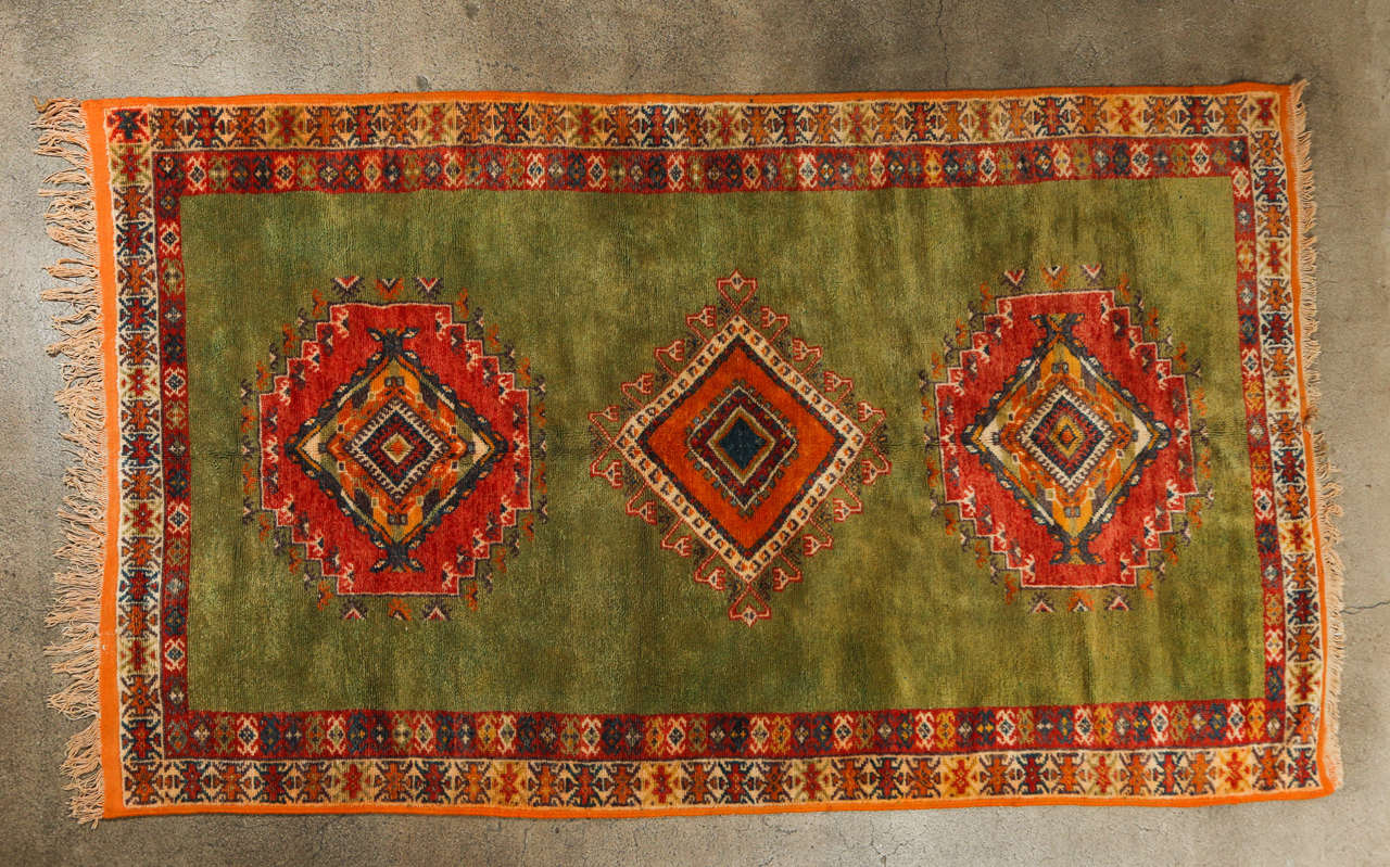 Handwoven by Berber women in Morocco using organic wool.