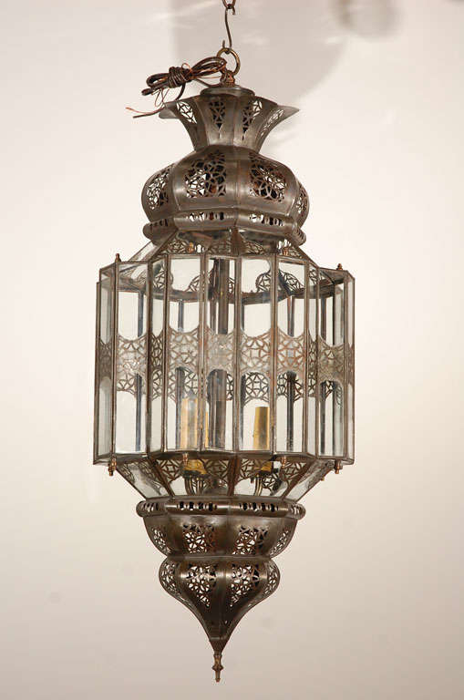Elegant and stylish clear glass handcrafted Moroccan lantern with intricate filigree work in Moorish style. Will add elegance in any room. Rewired with three lights, ready to use, comes with 3 feet chains and ceiling canopy.