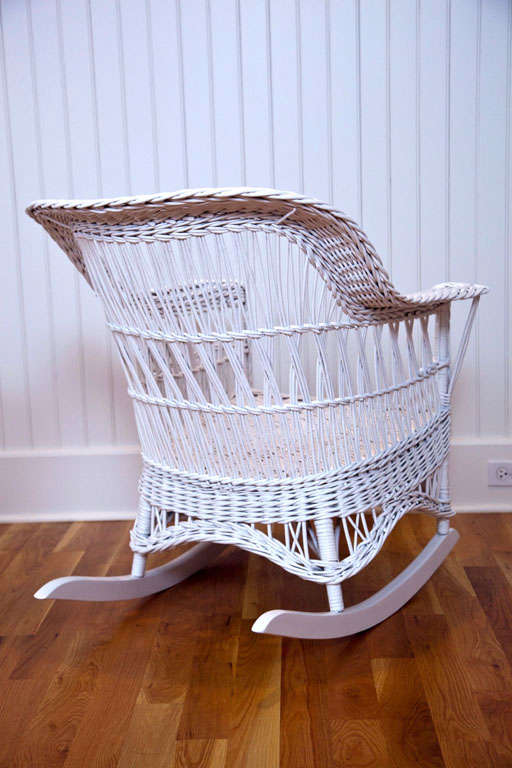 Antique wicker chair and rocker offered by the wicker shop of old