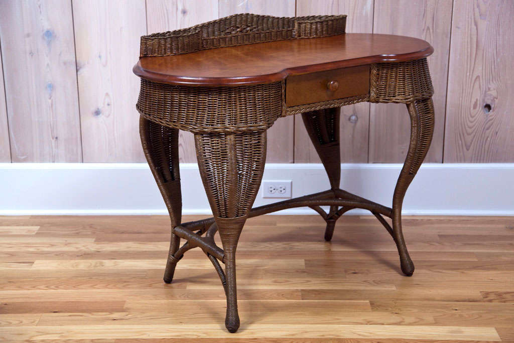 Beautiful Art Deco wicker desk with hard wood top. Diamond pattern in woven  gallery. - Antique Art Deco Wicker Desk At 1stdibs