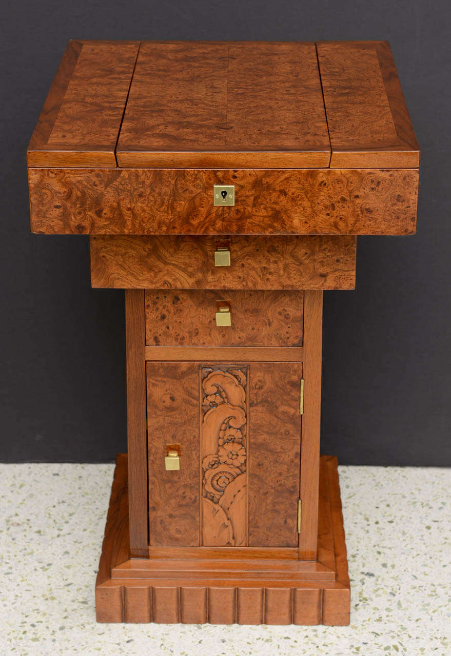The square top opening to reveal a work area over a carved door to reveal storage. Provenance: Aguttes, Drouot-Richelieu.