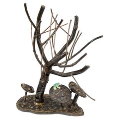 Vintage Sculpture of a Frog Perched on a Mushroom under a Tree