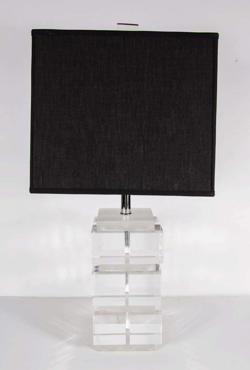 This lamp features three tiers of translucent Lucite cubes- six per side- with inset channels in frosted Lucite and polished nickel fittings. The lamp comes fitted with its rectangular cube finial. The lamp comes fitted with two Edison based sockets