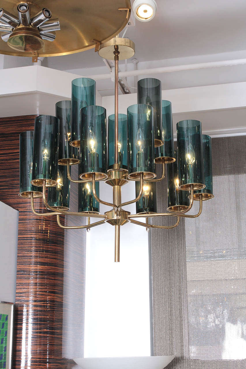 Fantastic Mid Century classic 2 tier brass chandelier with smoked blue glass tubes.
