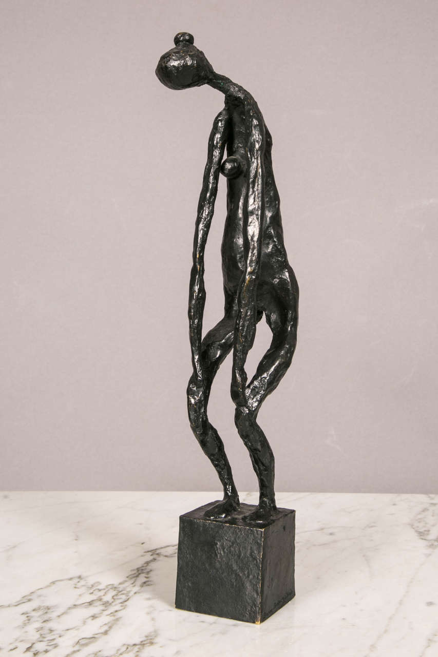 Black patinated bronze standing woman by Robert Couturier (1905-2008). Woman bending her head and her arms down to the knees.  Signed, numbered 2/6, Susse stamp on cubic base.