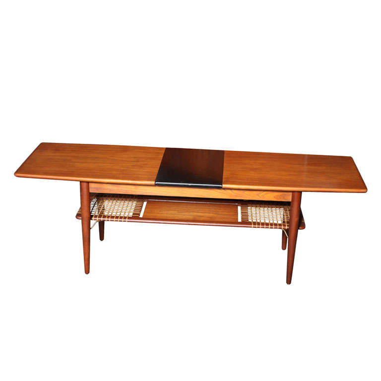 Teak coffee table with cane shelf and extension at 1stdibs for Coffee table extension