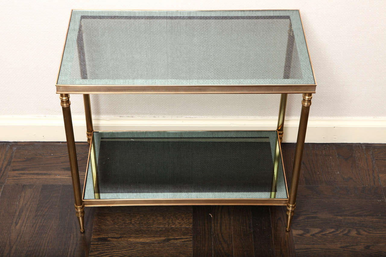 A Pair Of Gilt Brass And Smoked Glass Two Tier Etagere