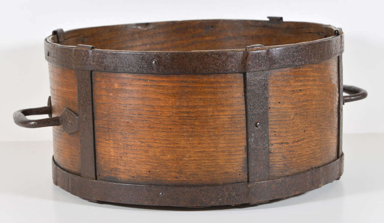 Oak and hand forged iron bin used for measuring grain. Has great handles.