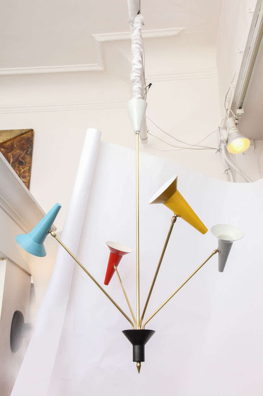A 1950s Italian articulated ceiling fixture signed Lumen.