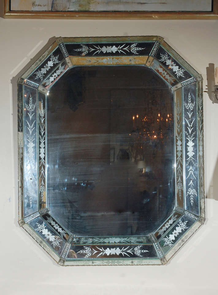 Beveled, octagonal, Venetian mirror with etched floral details.