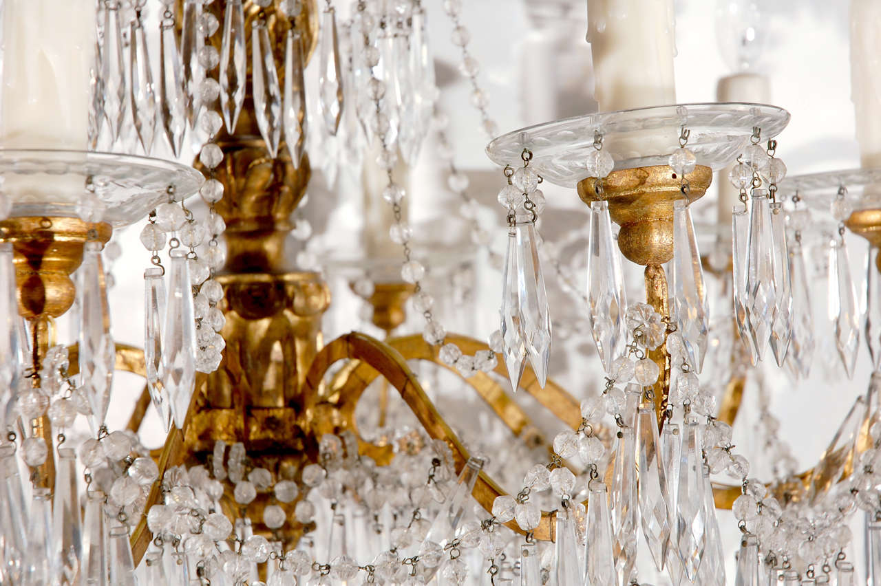 Gilded bronze chandelier with graceful strings of cut-crystal drops from Genoa, Italy.