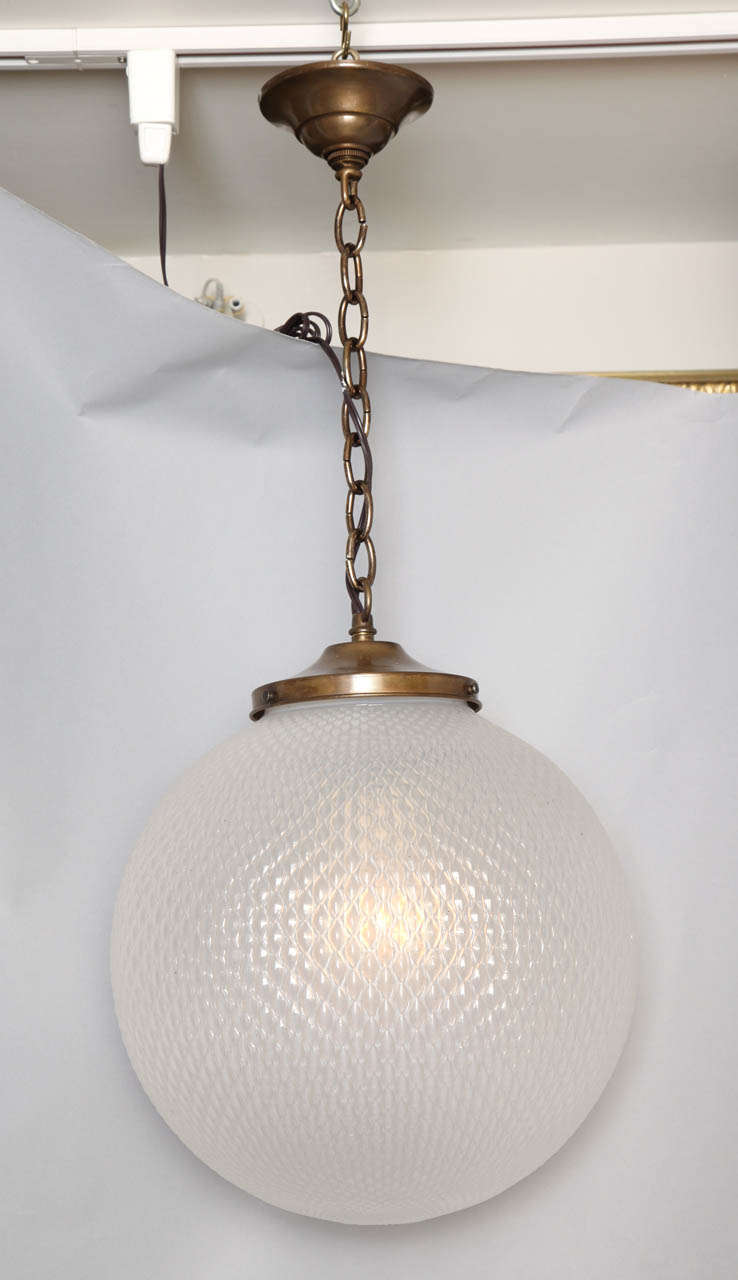 An Opalescent Gl Spherical Globe Light Fixture With Textured Surface And Silver Plated Nickel Metal Ings