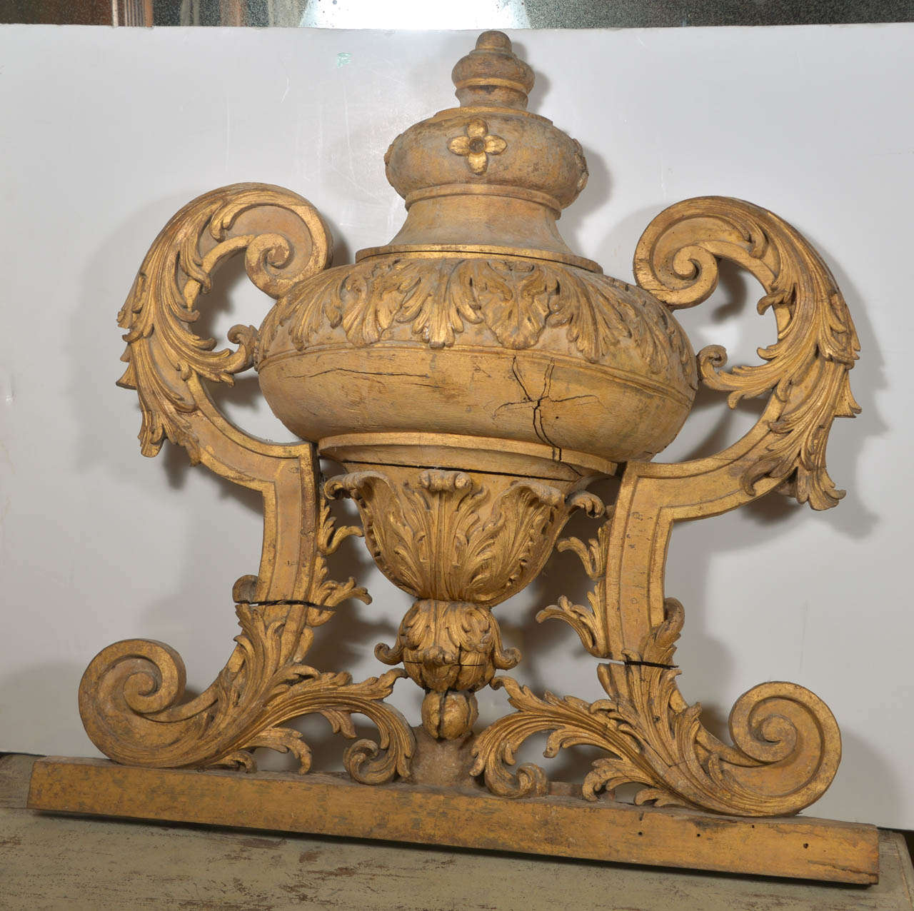 Large, beautifully carved and gilded large urn motif architectural fragment from Italy.