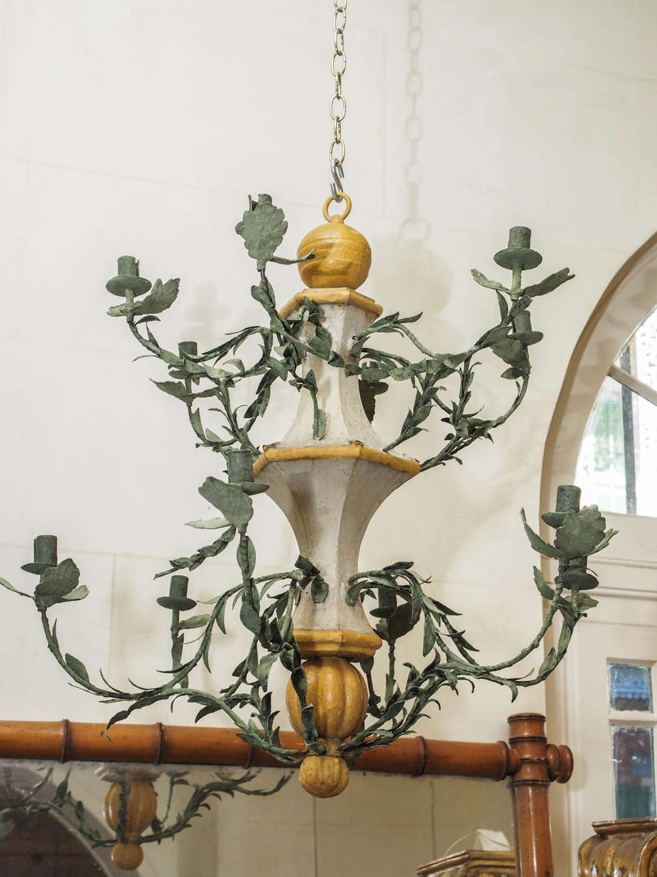 These late 18th century twelve-light l'orangerie chandeliers from the south of France have been meticulously restored. The stems and leaves are tole; it is not electrified.