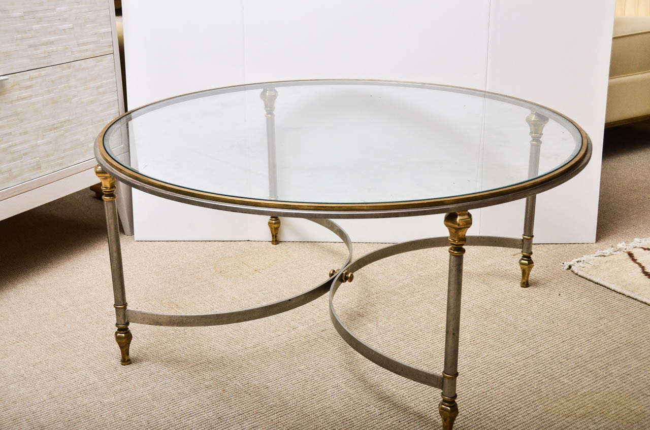 Round steel brass and glass cocktail table at 1stdibs Brass round coffee table