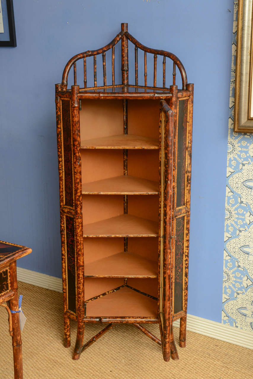 Incroyable Bamboo Corner Cabinet With Bent And Slatted Bamboo Accents At