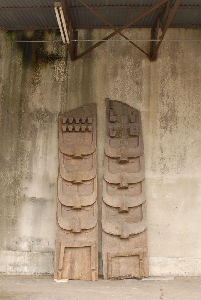 Two large size Indian wooden carvings from the early 20th century. These carved architectural pieces were situated on the facade of important Naga structures, in the Northern part of India. They were carved from a single large tree and depict the