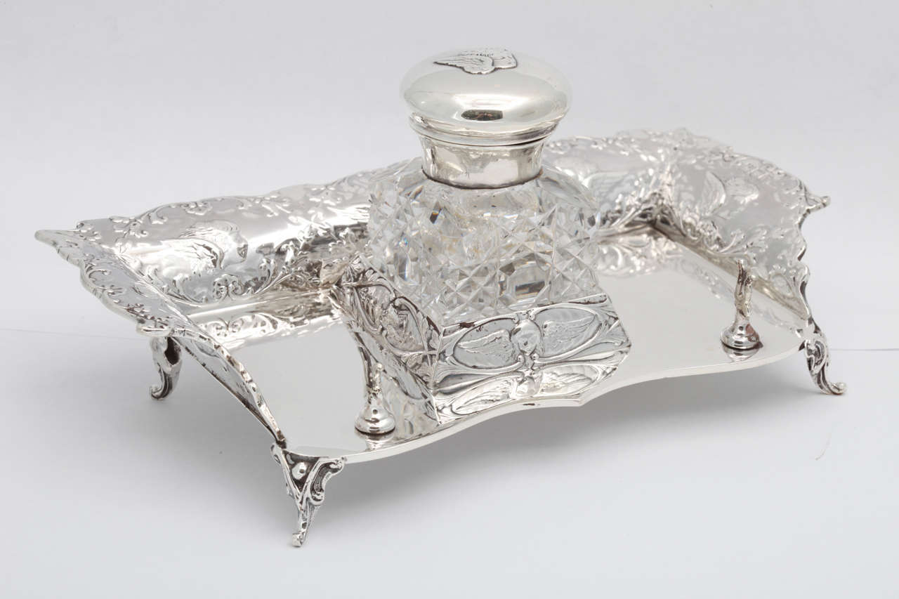 British Victorian, Sterling Silver Footed Cherub-Motif Inkstand By William Comyns For Sale