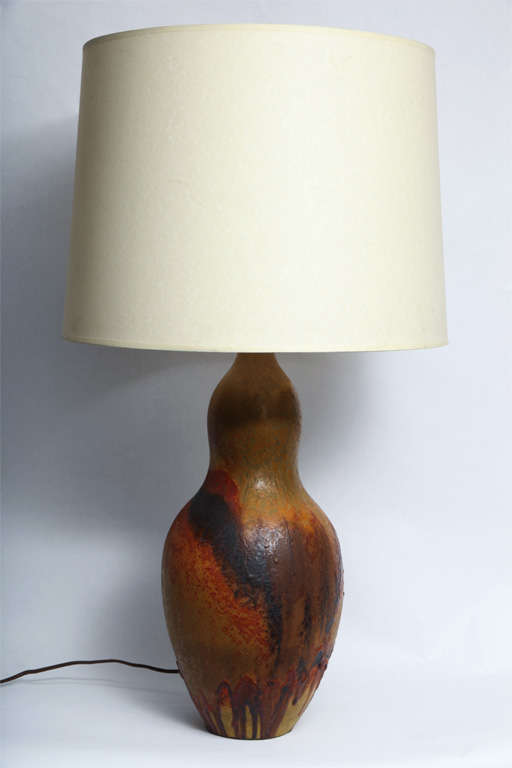 An Italian 1950s sculptural ceramic table lamp signed Fantoni. Shade not included