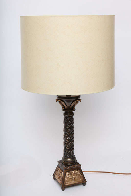 A pair of Austrian classical modern table lamps, produced circa 1920s, the architectural forms crafted of patinated and gilt bronze. Shades not included