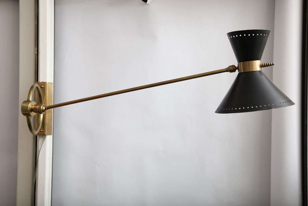 A 1950s, French articulated wall light.