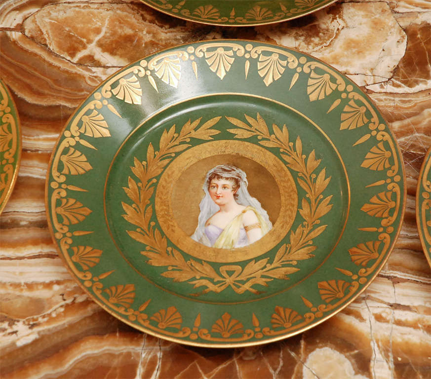 Group of 8 Sevres Porcelain Plates.  Hand Painted and Gilded.  Signed.