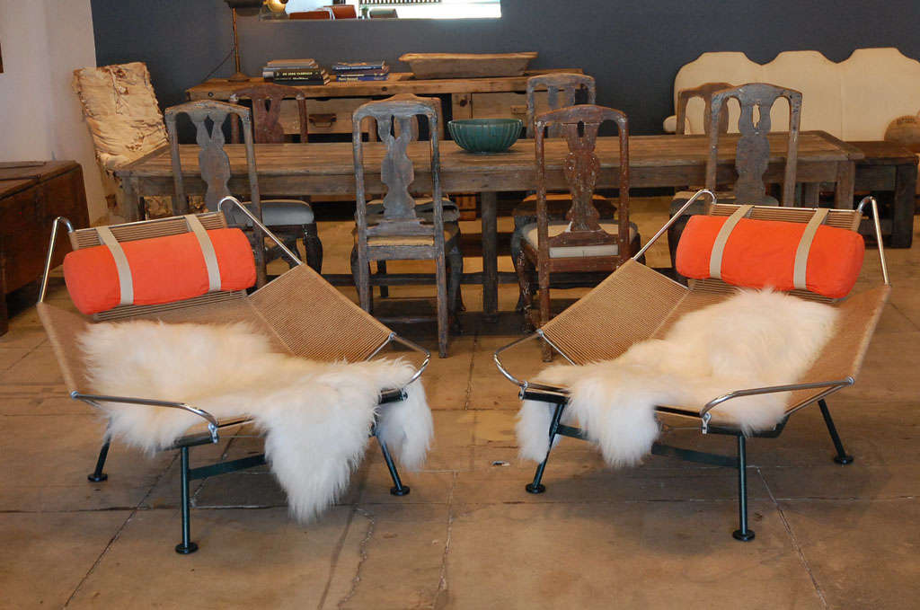 a pair of hans wegner's iconic halyard chairs produced in 1957 by getama. will consider selling separately.