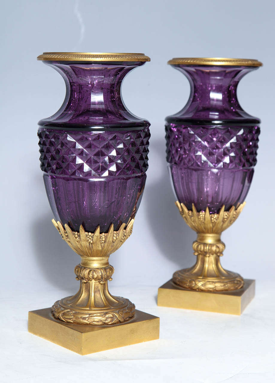A fine pair of Antique Russian of Amethyst cut crystal vases in doré bronze mounts. As so often happens, the artisans of the 19th century turned to nature for inspiration. Here we see the fire of precious amethyst captured in glass. The glass was