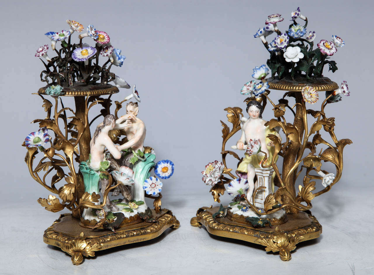 This pair of Meissen groups portray scenes of playful lovers in bowers of flowers embellished with mercury gilded bronze. The bowers are crowned with additional nosegays of porcelain flowers. Porcelain was so admired and treasured in the 18th
