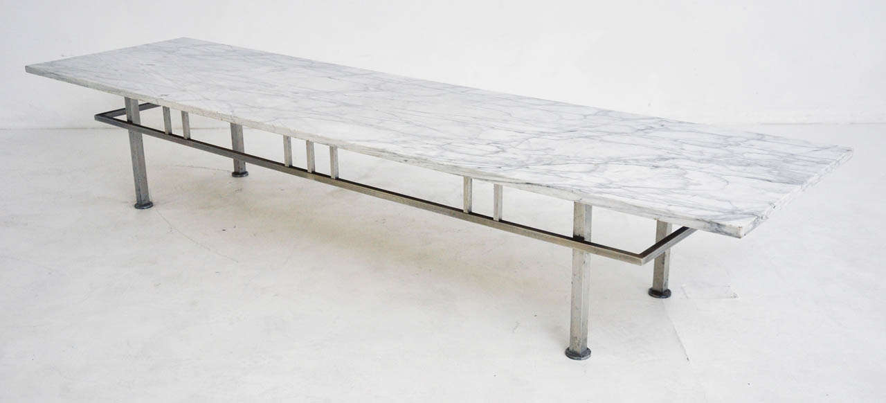 Marble top cocktail table over brushed metal base.