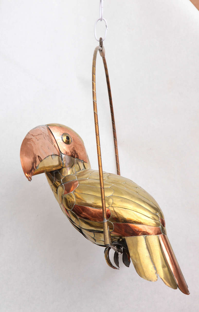 Whimsical brass and copper toucan sculpture by Mexican artist Sergio Bustamante.