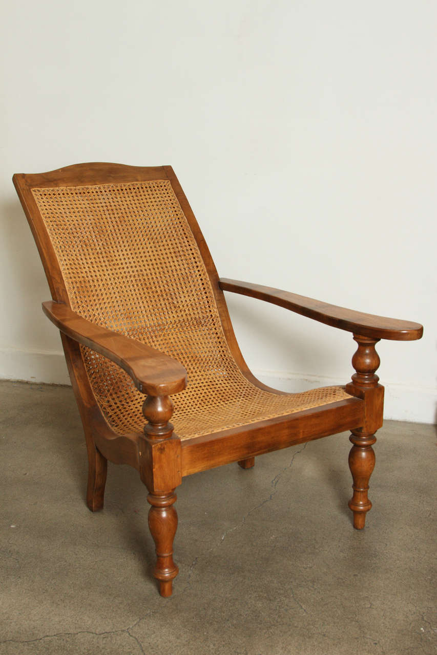 Anglo Indian Plantation Chair and Ottoman at 1stdibs