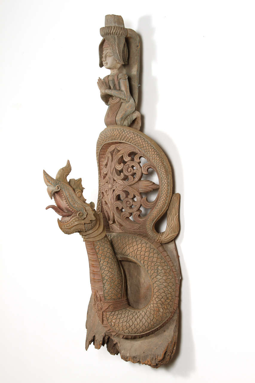 Asian Thai Buddhist sculpture of deity of fertility and dragon. Architectural wooden sacred architectural piece turned into a Buddhist art sculpture. Could be hang on the wall. The Dragon in Asian culture represent life, blessing and fertility.