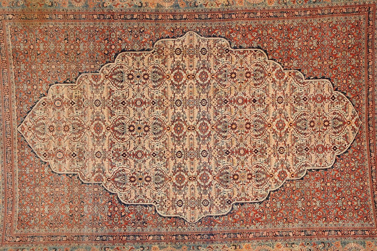 This Persian Haji Jalili Tabriz carpet, circa 1890 consists of a cotton warp and thread, hand-knotted wool pile and natural vegetable dyes. It is an exquisite and highly intricate piece from the workshop of master weaver Haji Jalili, one of the