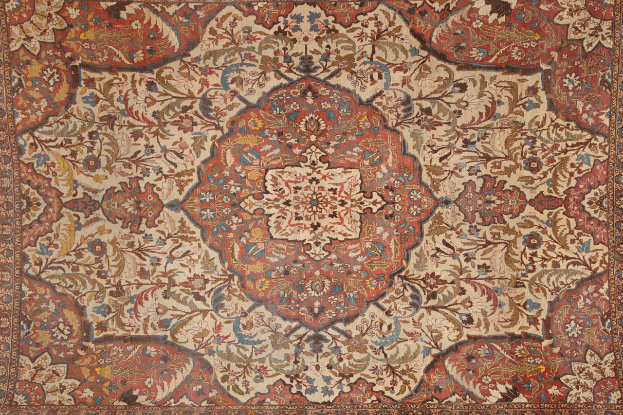 This Persian Haji Jalili Tabriz carpet circa 1880 consists of a cotton warp and thread, hand-knotted wool pile and natural vegetable dyes. It is an exceptional piece from the workship of master weaver Haji Jalili, one of the foremost artists of his