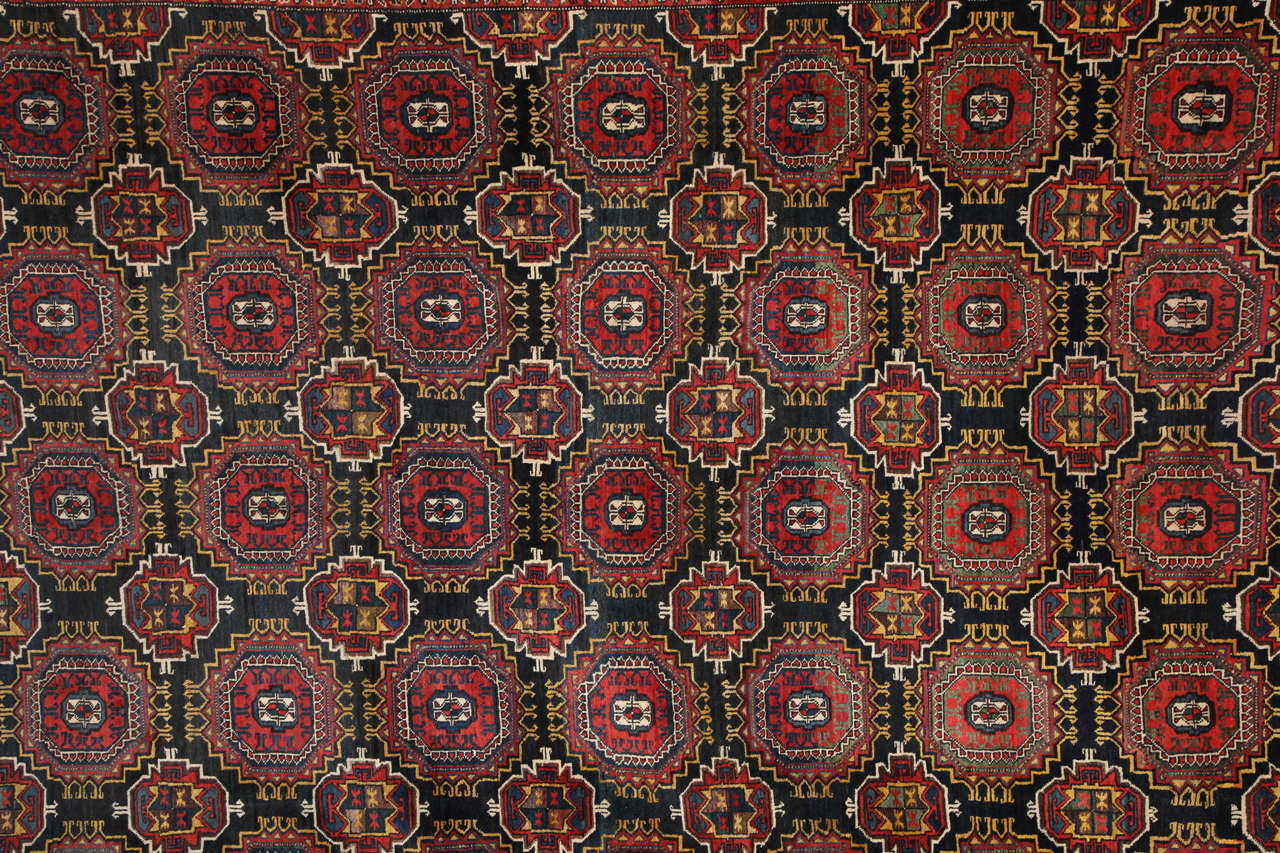 This Persian Amal Ziegler Bakhtiari carpet, circa 1890 consists of a handspun hand-knotted wool pile and natural vegetable dyes. The size is 11'7