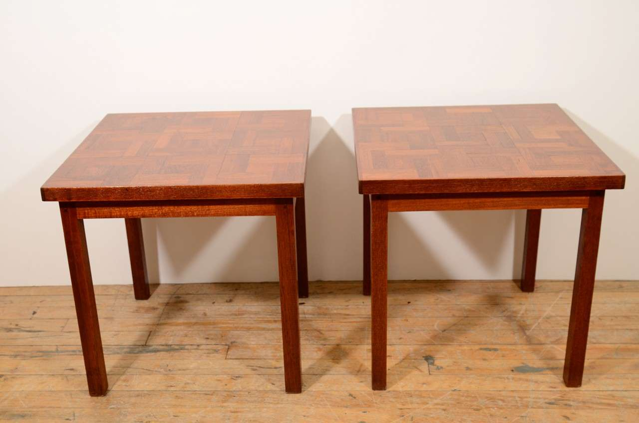 A pair of vintage side tables, produced circa 1960s, on wood frame with tile patterned wood surface. Markings include hand-written signature, dated 1967 beneath the table top. Very good condition, with age appropriate wear.